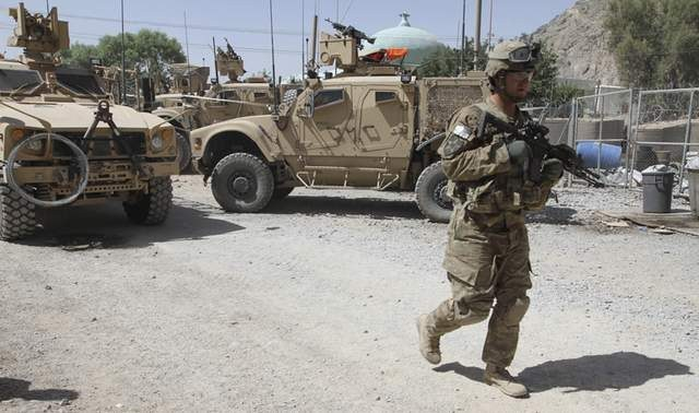 Afghan policeman was killed and three others were injured in southern Kandahar