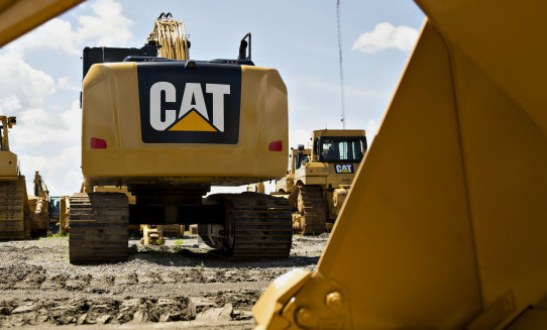 Caterpillar slashes revenue forecast may cut up to 10000 jobs by 2018