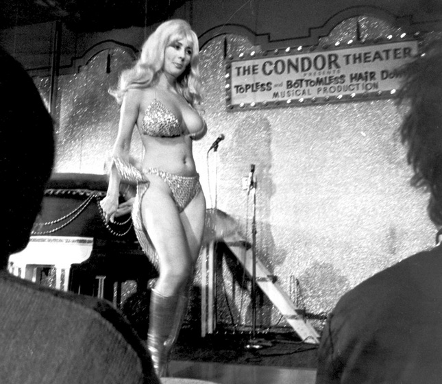 File - In this Sept. 21, 1978 file photo, Carol Doda performs at the Condor Theater in San Francisco. Doda, the legendary stripper who jiggled in America's first topless bar more than 50 years ago, has died in San Francisco of complications related to kidney failure, friends confirmed. She died Monday, Nov. 9, 2015 at age 78. (AP Photo/File)