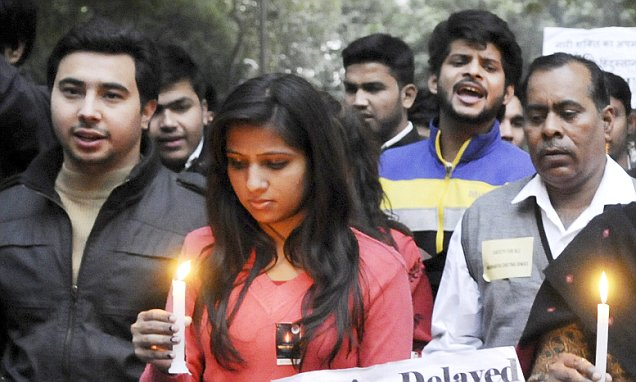 NEW DELHI, INDIA - DECEMBER 16: Protestors along with the mother of Nirbhaya taking out candle march on the third anniversary of the December 16 gang-rape for speedy trial of the case at Jantar Mantar on December 16, 2015 in New Delhi, India. Three years after the 23-year-old 'Nirbhaya' was brutally gang-raped on December 16, 2012, her mother revealed her name, saying my daughter was Jyoti Singh and I am not ashamed to name her. Section 228 A of the Indian Penal Code makes disclosure of the identity of a rape victim punishable. (Photo by Saumya Khandelwal/Hindustan Times via Getty Images)