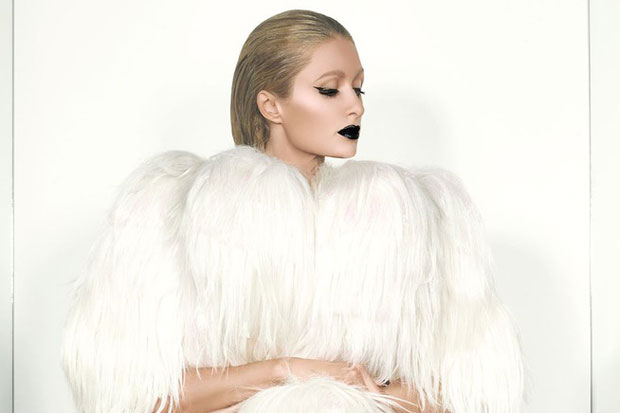 Paris-Hilton-tries-to-keep-up-with-her-former-sidekick-Kim-Kardashian-by-posing-for-her-own-cheeky-shoot-for-magazine