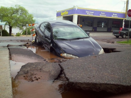 Massive-Sinkhole-Swallows-Car-With-Two-Year-Old-Girl-Trapped-Inside