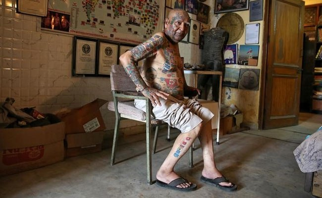 Indian man removes teeth and gets over 500 tattoos for world records