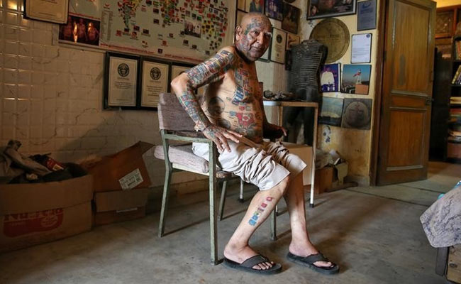 Indian-man-removes-teeth-and-gets-over-500-tattoos-for-world-records