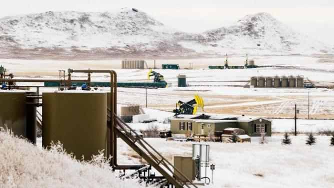Oil-prices-dip-on-brimming-crude-stocks-Canada-fires-move-away-from-oil-sands